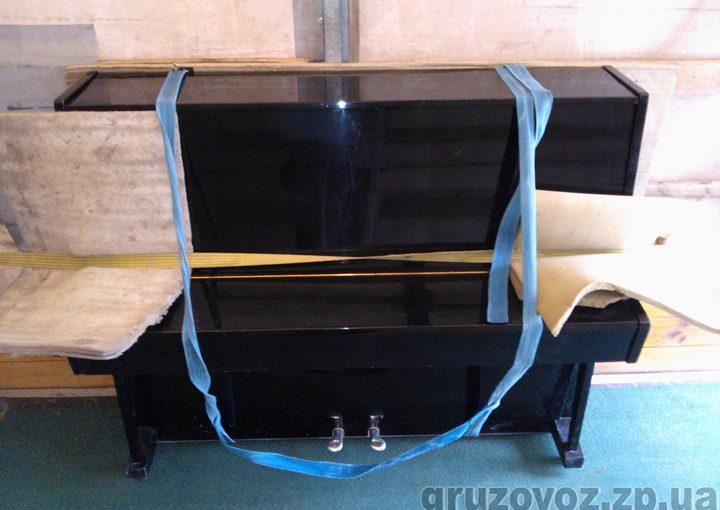 Перевозка по городу пианино Украина с грузчиками.